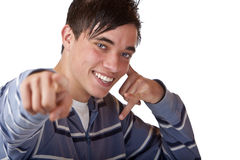 Young, nice teenager points with finger on camera Royalty Free Stock Photo