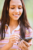 Young nice woman with PDA Royalty Free Stock Photo