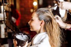 Beautiful woman in hair salon stock photos