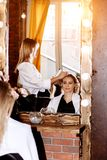 Beautiful woman in hair salon stock images