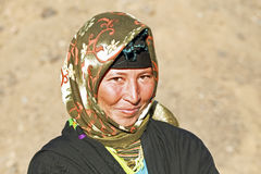 A young nomad woman in the desert Stock Photo