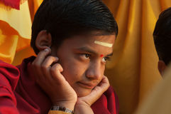 Young novice on Ganga Aarti ceremony in Parmarth Niketan ashram Stock Image