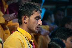 Young novice on Ganga Aarti ceremony in Parmarth Niketan ashram. RISHIKESH, INDIA - DEC 12, 2014: Unidentified young novice on Ganga Aarti ceremony in Parmarth stock photos