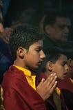 Young novice on Ganga Aarti ceremony in Parmarth Niketan ashram Royalty Free Stock Photo