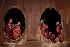 Young novice monks at window wooden Church Royalty Free Stock Image