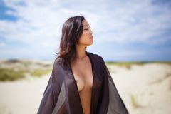 Young nude asian girl in the desert Stock Photo