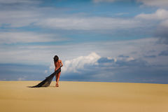 Young nude asian girl in the desert Royalty Free Stock Photography