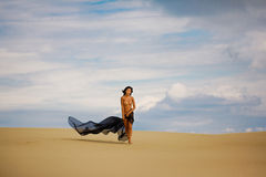 Young nude asian girl in the desert Stock Image