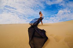 Young nude asian girl in the desert Stock Images