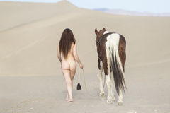 Young Nude Female Rider And Her Horse Stock Photo