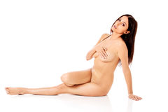Young nude woman sitting on the floor Royalty Free Stock Photo