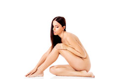 Young nude woman sitting on the floor Royalty Free Stock Image