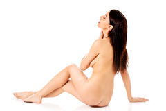 Young nude woman sitting on the floor Stock Photo