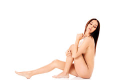 Young nude woman sitting on the floor Royalty Free Stock Images