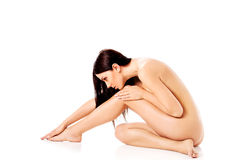 Young nude woman sitting on the floor Stock Photography