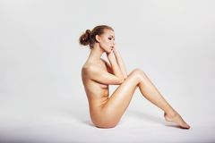 Young nude woman sitting in a nice posture Royalty Free Stock Image
