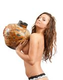 Young nudity girl with jug on white. Isolated Stock Photos