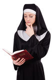 Young nun with bible isolated Stock Photos