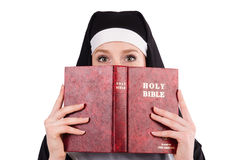 Young nun with bible Stock Image