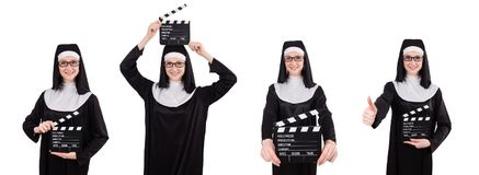 The young nun with clapperboard isolated on white. Young nun with clapperboard isolated on white Royalty Free Stock Photo