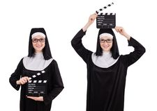 The young nun with clapperboard isolated on white. Young nun with clapperboard isolated on white Royalty Free Stock Photos