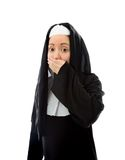 Young nun with hand over her mouth Stock Photography