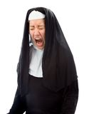 Young nun looking frustrated and shouting Stock Photo