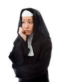 Young nun looking sad with her hand on chin Stock Photography