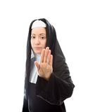 Young nun making stop gesture sign from both hands Royalty Free Stock Photo
