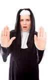 Young nun making stop gesture sign from both hands Stock Images