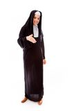 Young nun offering hand for handshake Stock Photography