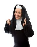 Young nun pointing towards camera from both hands Royalty Free Stock Photos