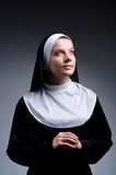 The young nun in religious concept Stock Image