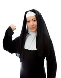 Young nun showing off her muscle Stock Image