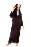 Young nun showing ok sign Royalty Free Stock Photo