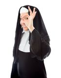 Young nun showing ok sign and smiling Stock Image