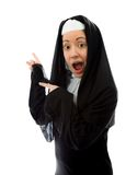 Young nun showing something Royalty Free Stock Photo