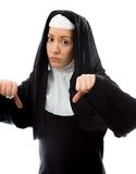 Young nun showing thumbs down sign from both hands Royalty Free Stock Photo