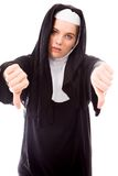 Young nun showing thumbs down sign from both hands Stock Photo