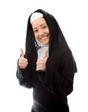 Young nun showing thumbs up sign with both hands Stock Image