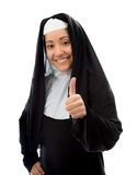 Young nun showing thumbs up sign and smiling Royalty Free Stock Photo