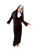 Young nun smiling with arm outstretched Royalty Free Stock Images