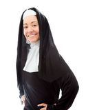 Young nun smiling with her arms akimbo Royalty Free Stock Images