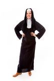 Young nun smiling with her arms akimbo Royalty Free Stock Photography