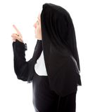 Young nun thinking and pointing up Stock Image