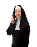 Young nun wishing with crossing fingers Royalty Free Stock Photos