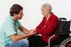 Young nurse assisting disabled lady Royalty Free Stock Images