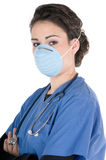 Young nurse, blue scrubs, mask, stethoscope Royalty Free Stock Photo