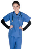 Young nurse, blue scrubs and stethoscope, isolated. Young female nurse, wearing blue scrubs and stethoscope around the neck, isolated on white background stock image