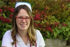 Young nurse with cap  outdoors Stock Photos